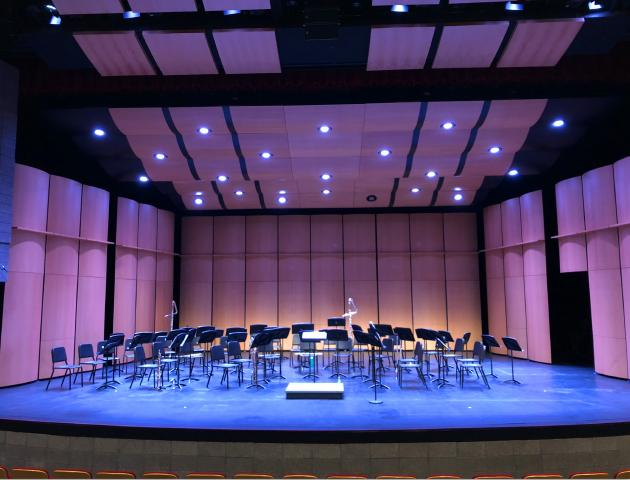 Performing arts center stage with music stands