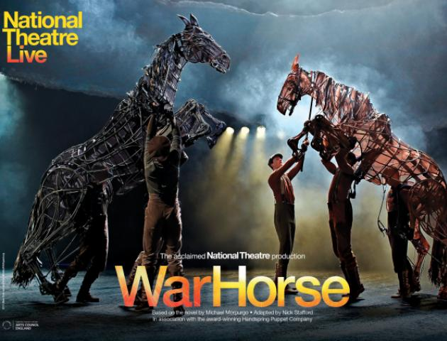 Two life sized war horse puppets on stage with five puppeteer operators on stage