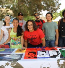 Students with artwork on campus