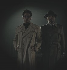 Two men in dark