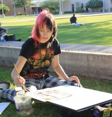 artist painting on campus