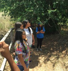 HOOP students enjoying the shade while listening to park ranger in New Mexico.