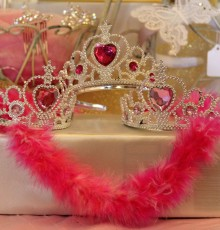 Child size princess tiaras set on table for event