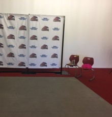 Mesa Community College backdrop with the Thunderbird logo set in PAC lobby