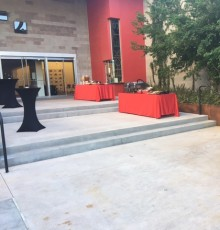 Courtyard of the PAC set with high-top tables and buffet of food.