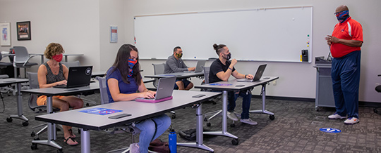 Classroom with students and instructor wearing masks while being socially distant