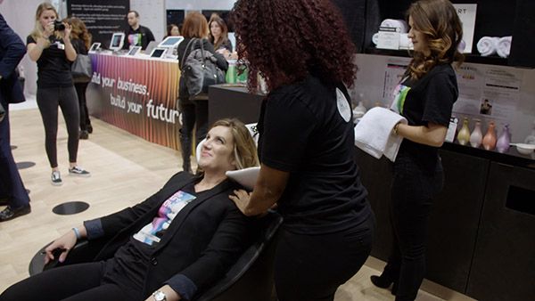 Hair stylist working on a woman's hair