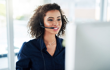 Young woman speaking on phone through a headset