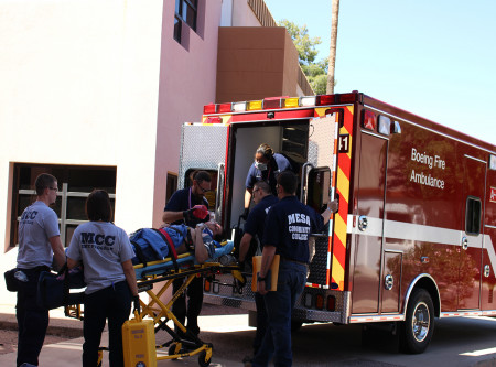 Patient being loaded into ambulance