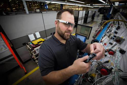 boeing mesa employee works on electrical cable harness wiring in the  electrical center of excellence