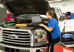 Girl working on Ford truck