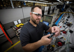 Boeing Mesa Employee works on electrical cable harness wiring in the Electrical Center of Excellence.