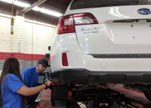 MCC students work on Subaru vehicle.